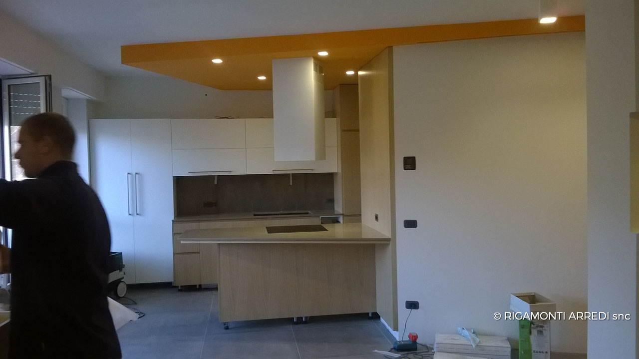 kitchen in oak and laminated wood rigamonti arredi